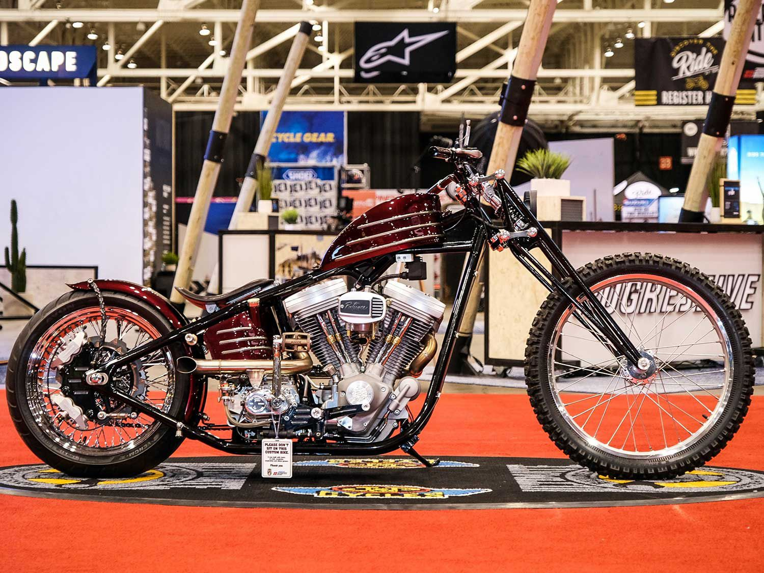 Austin Andrella with Austin Martin Originals grabbed first place in Freestyle with this sweet 2009 stretched Harley-Davidson AMO Rigid, which sports a suicide shift, handmade fuel tank, and paint by Flamethrower Customs and Atomic Bob.