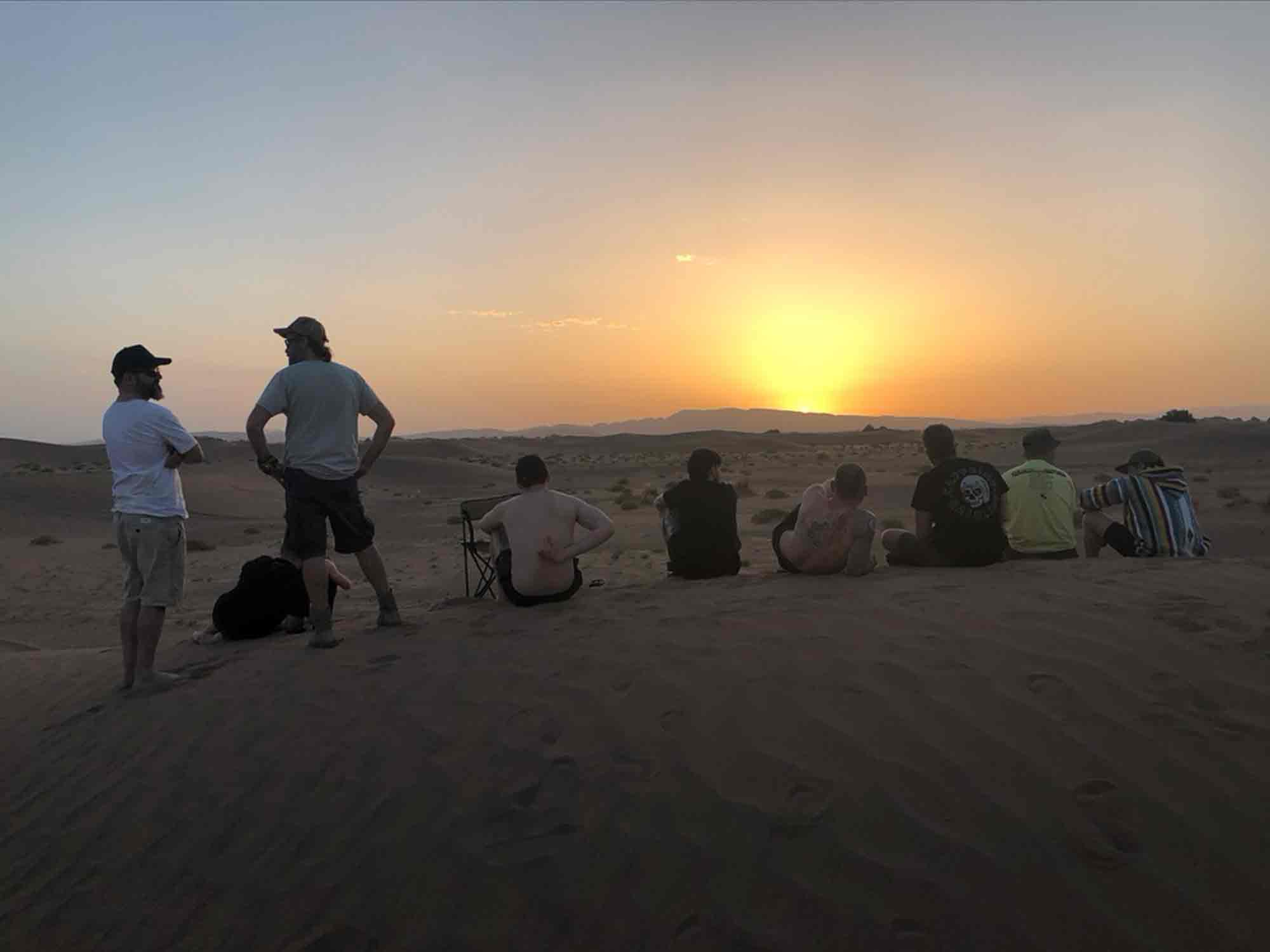 The team sits on a dune to appreciate the sunset after one of our toughest days. Nothing brings people together like a challenge, and this ride was one hell of a challenge.