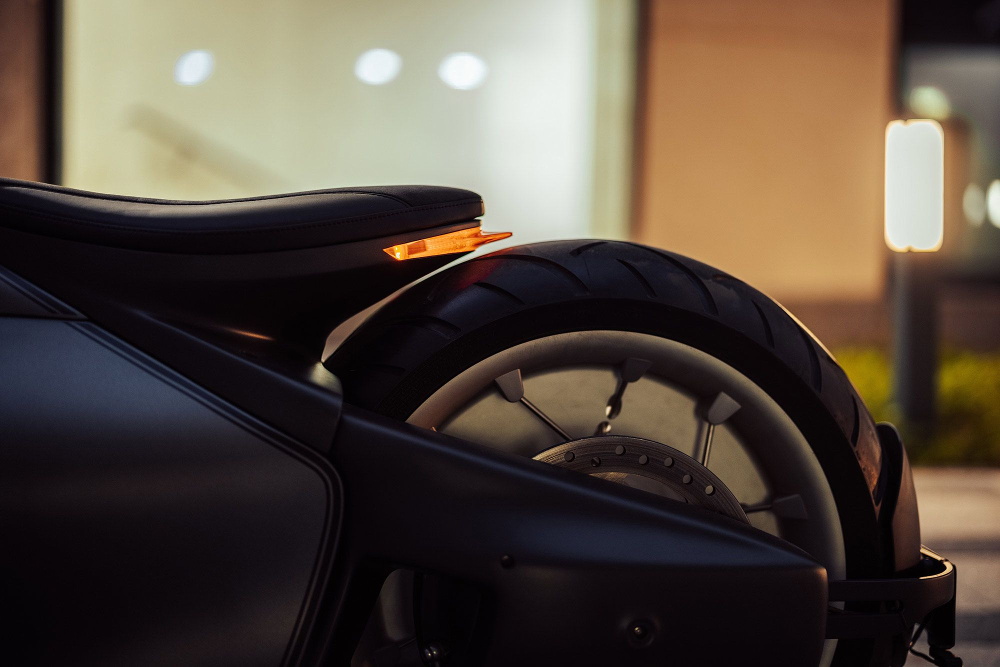 Custom seat has LED taillight integrated into the back. Air suspension or not, that is not a lot of separation between saddle and tire.