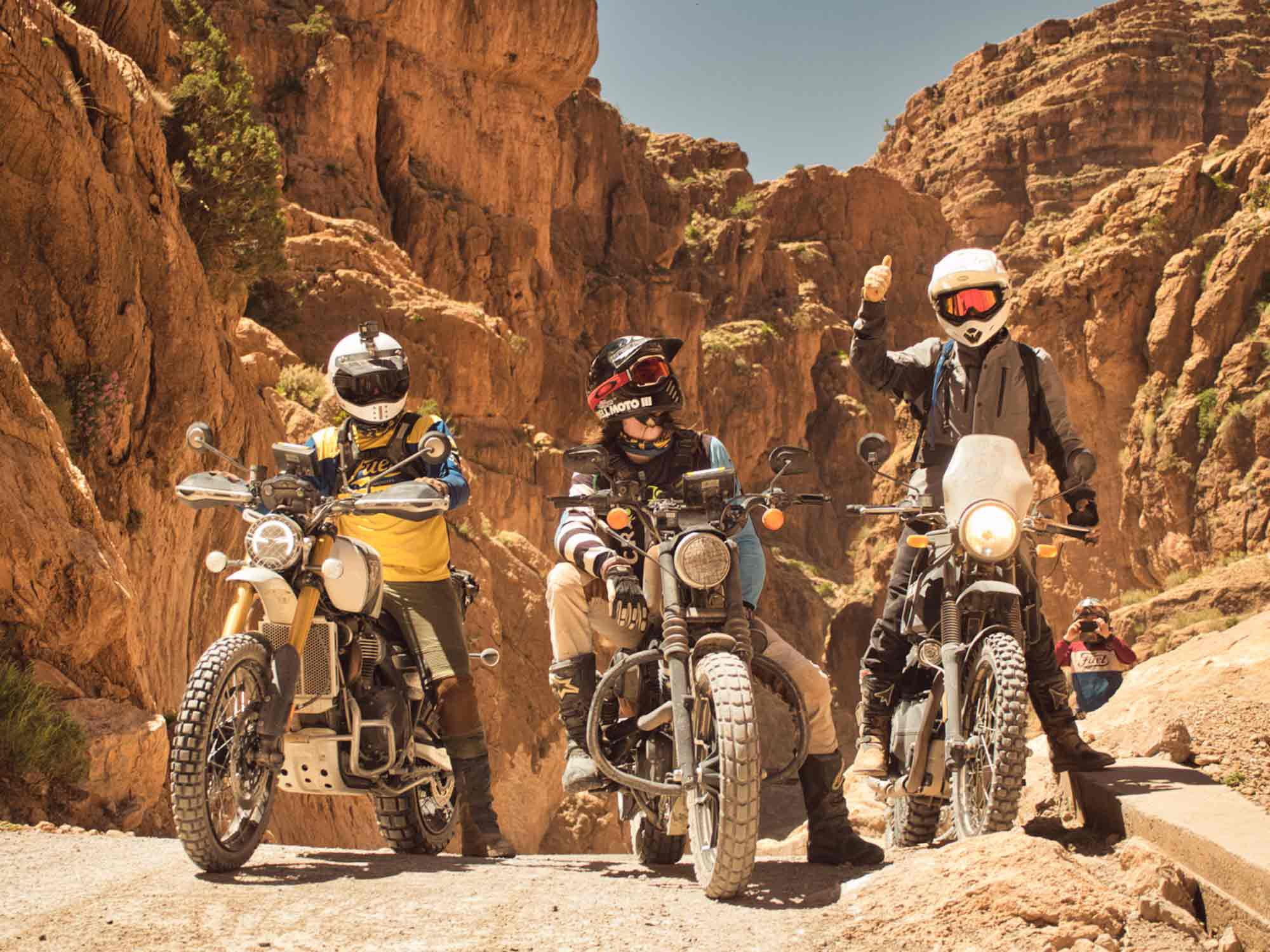 Dominik on the left on his Triumph Scrambler, me in the middle, and David on the right as we pass through Dadès Gorges.