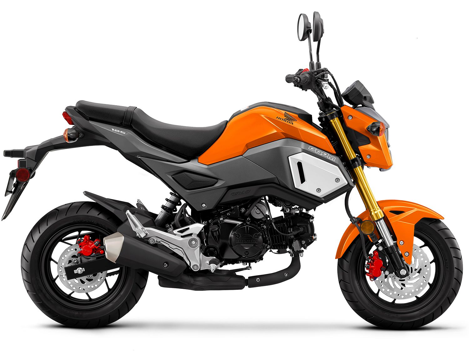 The Grom's low seat height comes courtesy of puny 12-inch tires, but don't underestimate this bike's fun factor.