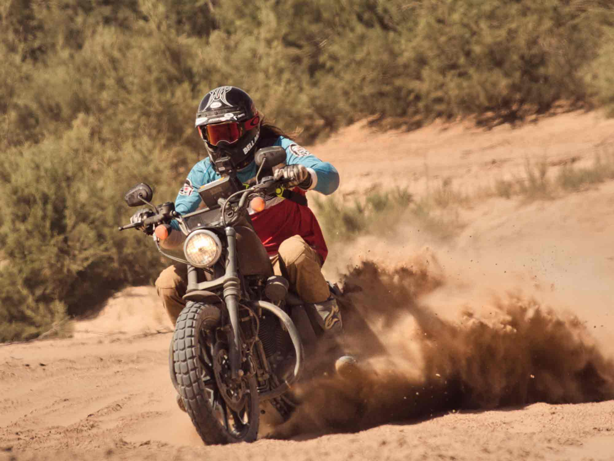 The back tire spitting out clouds of red sand, keeping the front tire barely above it. Pinned in third gear, I make it through the fesh-fesh.