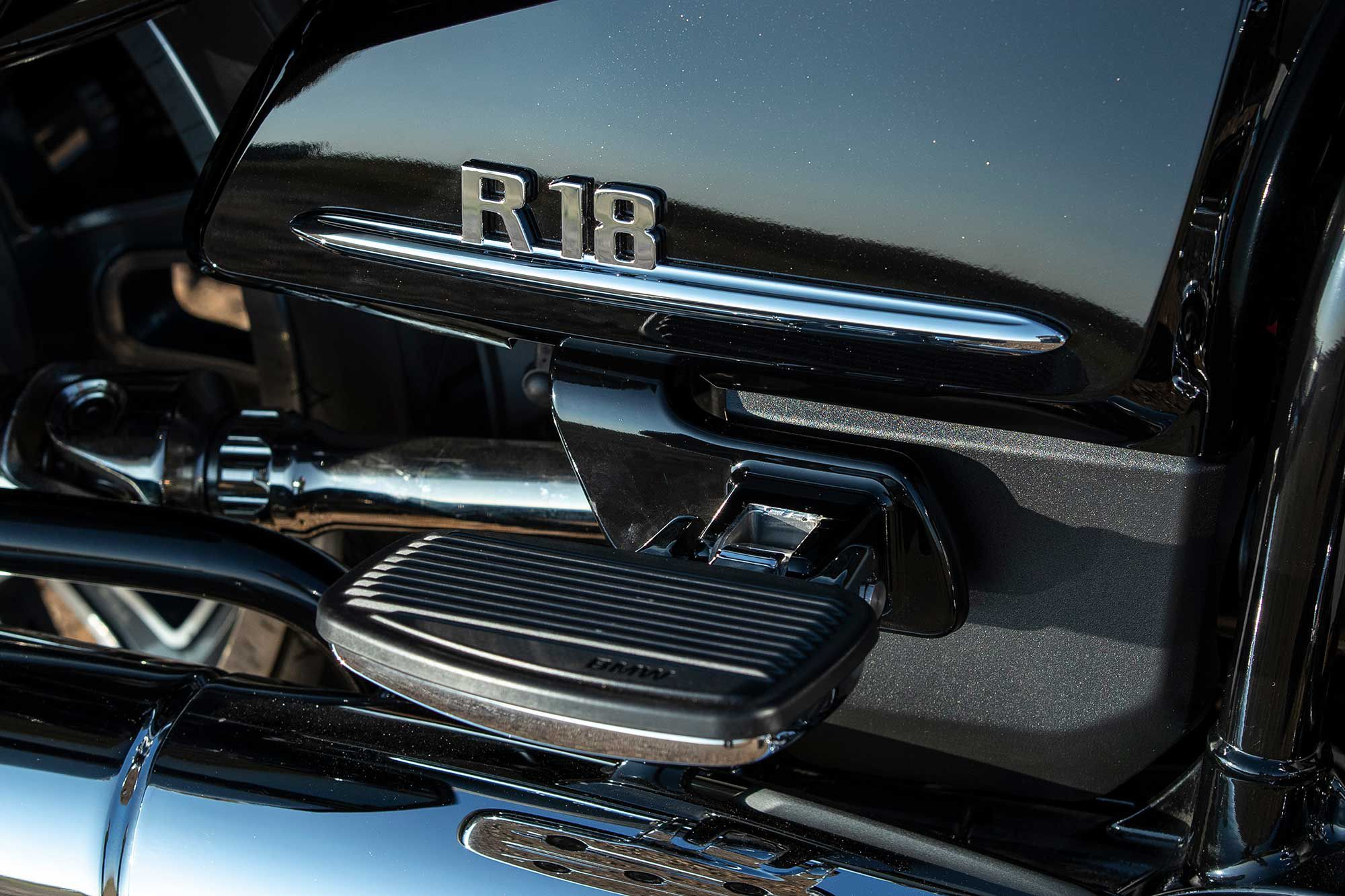 Although passenger floorboards are a welcome amenity, they cover the handsome R 18 badge when folded up.
