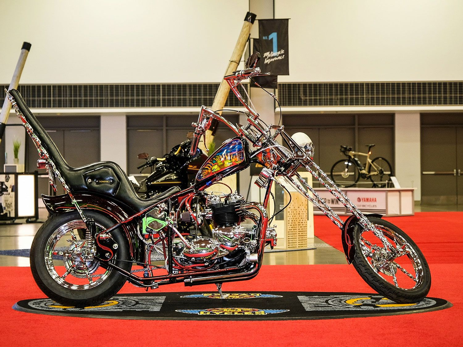 "Joseph ""Lefty"" Hyde's 1973 Triumph Tiger, painted by Tim Becker and Monti Roach, took home first place in the Custom Classic category. Check out the skull headlight and '60s-style sissy bar."